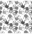 seamless pattern of prints of hands vector image vector image