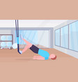 sporty man doing exercises with suspension fitness vector image vector image