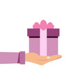 hand holding or offering gift or present with pink vector image vector image