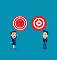 business person throwing darts at dart board vector image