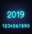 glowing neon numbers set on brick wall vector image vector image