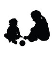 children silhouette with ball vector image vector image