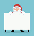 Christmas card of santa claus behind white sign or