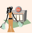 woman holds shopping bag and retro store grunge vector image