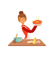 young smiling woman holding freshly baked pie vector image