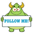 horned green monster holding follow me sign vector image vector image