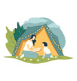 mom reading stories to kid sitting tent vector image vector image