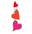 three red and pink hearts on the rope on white vector image