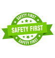 safety first ribbon safety first round green sign vector image vector image