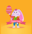 rabbit in clothes holding an easter egg vector image vector image