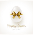 white egg with glitter gold ribbon bow vector image