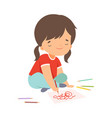 cute girl sitting on floor and drawing picture