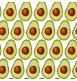 seamless background of halved avocado fruit vector image vector image