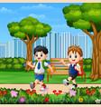 two boys go to school through park road vector image vector image