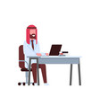 arab male doctor using laptop at workplace desk vector image