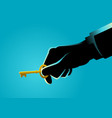 businessman hand holding a golden key vector image