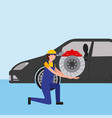 mechanic on the knee with brake disc auto part vector image vector image