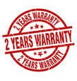 2 years warranty round red grunge stamp