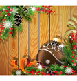 Brown Christmas ball on wooden background vector image vector image