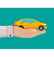 Hand with yellow car vector image vector image