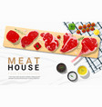 raw beef steaks with seasoning on cutting board vector image vector image