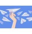 White paper airplane in the female hand and other vector image vector image