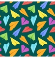 Seamless pattern with colored paper planes against vector image