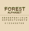 work of forest trees green nature font uppercase vector image