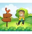 A boy smiling in the garden with a wooden arrow vector image vector image