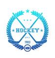 hockey emblem logo with crossed sticks blue over vector image