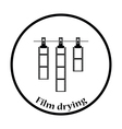 Icon of photo film drying on rope with clothespin vector image