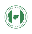 made in nigeria round label vector image vector image