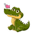 adorable little green crocodile with bird perched vector image