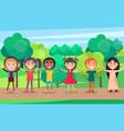 happy children holding hands in summer park vector image vector image