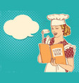 young woman chef holding cook book in her hand on vector image vector image