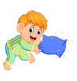 a boy playing pillow vector image vector image
