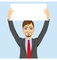 Businessman holding white blank board