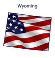 wyoming full american flag waving in wind vector image