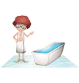 A boy with a towel beside a bathtub vector image vector image