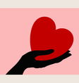 Heart in a hand vector image vector image