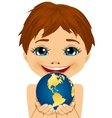 caucasian little boy holding earth globe vector image vector image