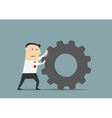 Businessman pushes a huge gear vector image