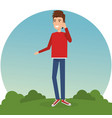 young man calling in the park vector image