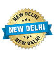 New Delhi round golden badge with blue ribbon vector image vector image
