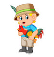 young man carrying a rooster vector image vector image