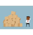 Worried businessman and large pile of boxes vector image