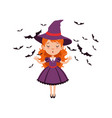 young red-haired girl witch standing with hands up vector image
