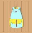 backpack hanging on hook on wall vector image vector image