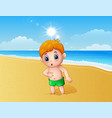 boy playing a sand using his feet at the beach vector image vector image