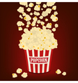 Popcorn falling in the striped popcorn bag vector image